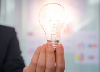 Person holding a light bulb