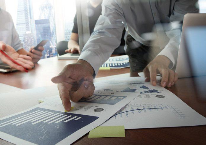 man pointing at spreadsheet