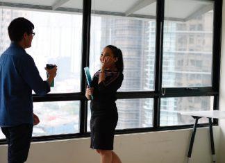 employees talking in an office