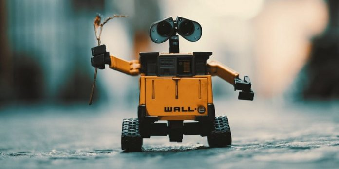 robot moving down street