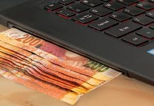 money coming out of a laptop