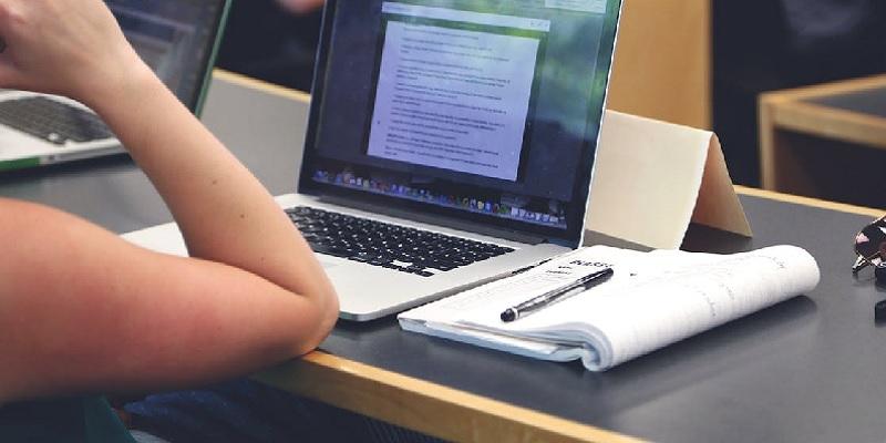 woman looking at computer screen