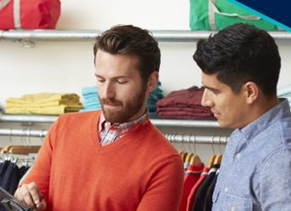 two men looking at clothes