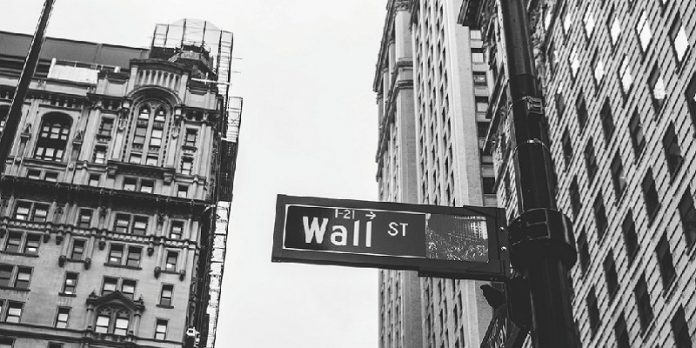 street sign saying 'wall st'