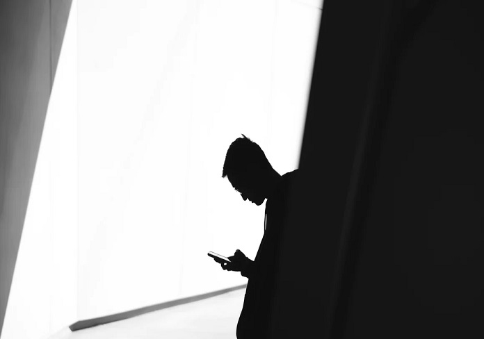 silhouette of phone user