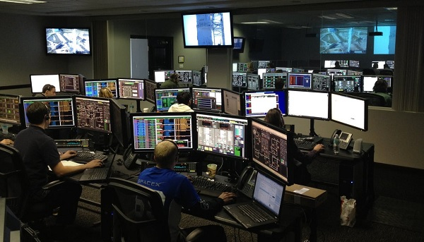 worker looking at multiple screens